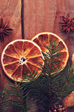 Dried oranges and fir tree branch on rustic wooden background Royalty Free Stock Photo