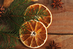 Dried oranges and fir tree branch on rustic wooden background Royalty Free Stock Images