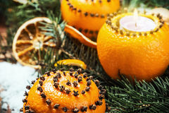 Dried oranges with nuts and burning candles Stock Photography