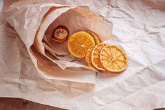 Dried oranges in a paper paper bag Stock Photo