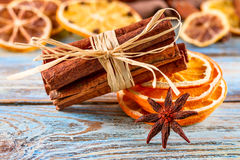 Dried oranges, star anise, cinnamon sticks on blue wooden background - Christmas composition, still life Royalty Free Stock Images