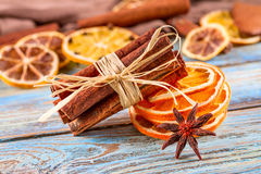 Dried oranges, star anise, cinnamon sticks on blue wooden background - Christmas composition, still life Stock Photos
