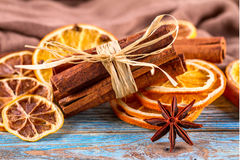 Dried oranges, star anise, cinnamon sticks on blue wooden background - Christmas composition, still life Stock Images