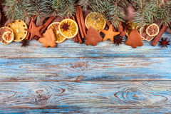 Dried oranges, star anise, cinnamon sticks and gingerbread on a blue wooden background -- Christmas background Stock Photography