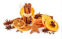 Dried oranges, star anise, cinnamon sticks and gingerbread, isolated on white Stock Photography