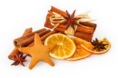 Dried oranges, star anise, cinnamon sticks and gingerbread, isolated on white Royalty Free Stock Images