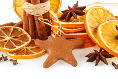 Dried oranges, star anise, cinnamon sticks and gingerbread, isolated on white Royalty Free Stock Photos