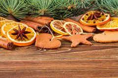 Dried oranges, star anise, cinnamon sticks and gingerbread on a wooden background -- Christmas background Stock Photos