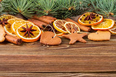 Dried oranges, star anise, cinnamon sticks and gingerbread on a wooden background -- Christmas background Stock Images
