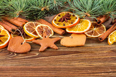 Dried oranges, star anise, cinnamon sticks and gingerbread on a wooden background -- Christmas background Stock Image