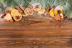 Dried oranges, star anise, cinnamon sticks and gingerbread on a wooden background -- Christmas sti Royalty Free Stock Photos