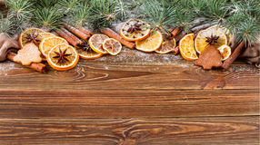 Dried oranges, star anise, cinnamon sticks and gingerbread on a wooden background -- Christmas sti Royalty Free Stock Photography
