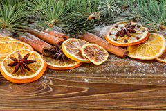 Dried oranges, star anise, cinnamon sticks and gingerbread on a wooden background -- Christmas sti Stock Photography