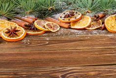 Dried oranges, star anise, cinnamon sticks and gingerbread on a wooden background -- Christmas sti Stock Photos
