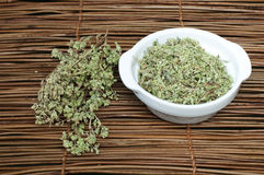 Dried oregano in a bowl Royalty Free Stock Images
