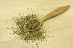Dried oregano herb in a wooden spoon Stock Photography