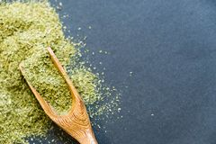 Dried oregano herbs in wooden spoon. Natural light. Selective focus. Close up on a black background. Top view, flat lay. copy spac Royalty Free Stock Photography