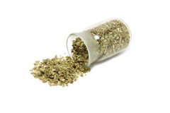 Dried oregano leaves in a bottle with glass Stock Photo