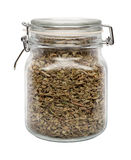 Dried Oregano Leaves in a Glass Canister Royalty Free Stock Photography