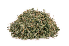 Dried oregano leaves on a white background.  Stock Images