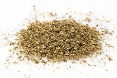 Dried oregano. A pile of dried oregano on a white background Stock Photography