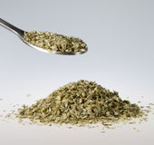 Dried oregano on Tablespoon Stock Photo