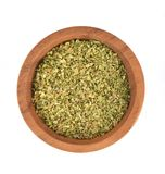 Dried Oregano in wooden bowl on white background Top view royalty free stock photography