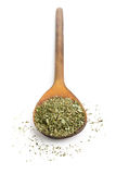 Dried oregano on wooden spoon Stock Images