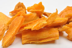 dried organic mango and a white background Royalty Free Stock Images
