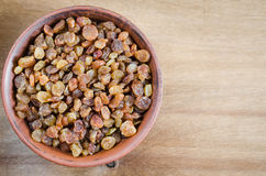 Dried Organic Raisin in Bowl on Wooden Background. Royalty Free Stock Photos