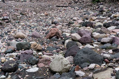 Dried out river bed with rocks and sand. Royalty Free Stock Photo