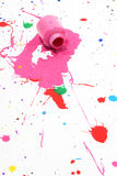 Dried Paint Spill. Spilt bottle of pink paint.  Dried and cracked on floor Royalty Free Stock Photos