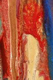 Dried paints. Composition of colorful paints containing glittering particles in blue, copper, gold and red Stock Photography