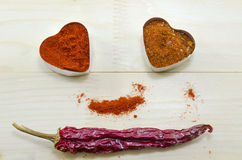 Dried paprika and pepper in heart shaped containers Royalty Free Stock Photography