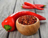 Dried paprika. In a wooden bowl on a gray background Stock Image