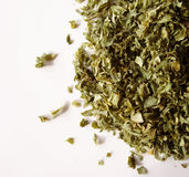 Dried parsley flakes. On white background royalty free stock images