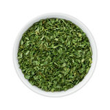 Dried Parsley Flakes in a Ceramic Bowl Royalty Free Stock Photo