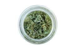 Dried parsley in a glass jar, viewed from above Royalty Free Stock Images