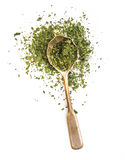 Dried parsley in a spoon Royalty Free Stock Photos