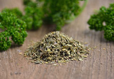 Dried parsley on wooden Royalty Free Stock Images
