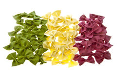 Dried pasta bows in the shape of the Italian Flag. Dried pasta bows in the shape and colours of the Italian Flag on white background Stock Photos