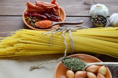 Dried pasta tied with string  with spices stock photography