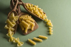 Dried pasta in wood spoon Stock Image