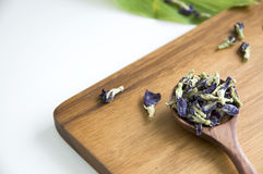 Dried pea flower on cutting board Stock Image