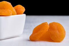 Dried peach on white table Stock Photos