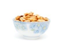 A dried peanut bowl. A full un-shell peanut bowl Stock Photography