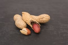 Dried peanuts close-up on a black background. royalty free stock photos