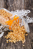 Dried peas in a glass jar on white lace napkin. Royalty Free Stock Photos