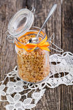 Dried peas in a glass jar on white lace napkin. Royalty Free Stock Photo