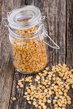 Dried peas in a glass jar on wooden table. Stock Photo